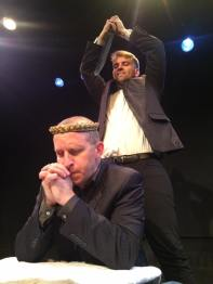 J.WARREN WEBER as Hamlet sneaks up on JASON HOWARD as Claudius